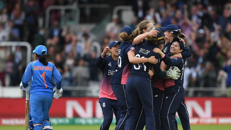 Anya Shrubsole is mobbed by her England team-mates after sealing the World Cup win at Lord's