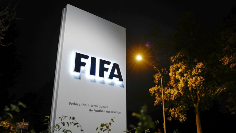 A sign of the FIFA is seen at the entrance of the world football's governing body headquarters on October 13, 2016 in Zurich