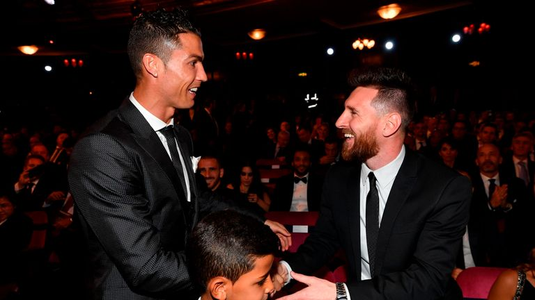 Nominees for the Best FIFA football player, Barcelona and Argentina forward Lionel Messi (R) and Real Madrid and Portugal forward Cristiano Ronaldo (L) cha