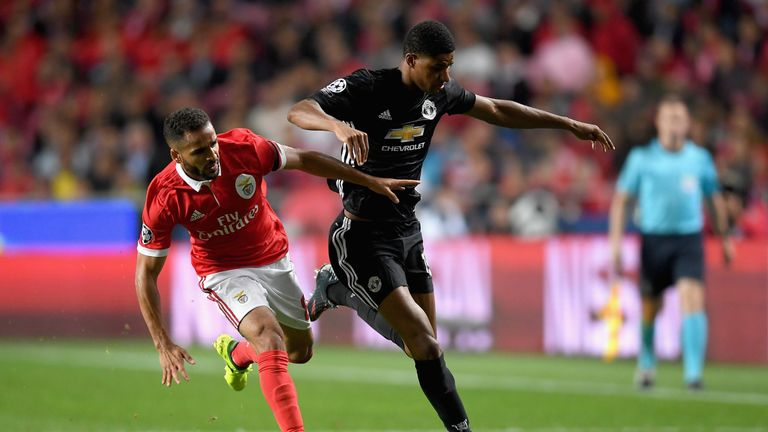 Marcus Rashford takes on Douglas in the first half