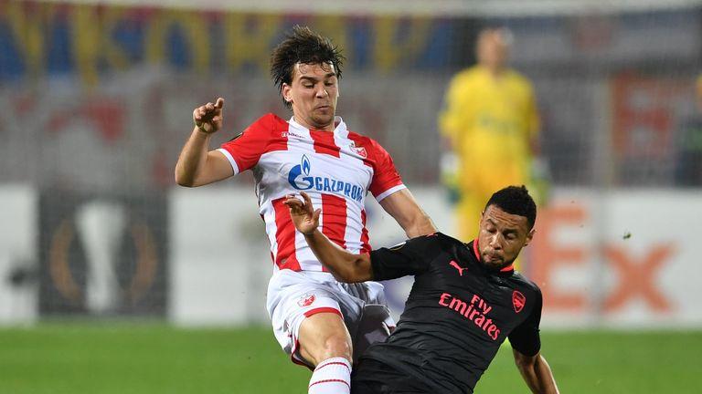 Filip Stojkovic (L) vies with Arsenal's midfielder Francis Coquelin