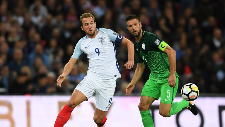 Harry Kane of England evades Bostjan Cesar of Slovenia during the FIFA 2018 World Cup  Group F Qualifier between England and Slovenia