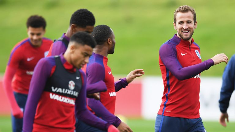 Harry Kane talks with England team-mate Raheem Sterling during a training session at St George's Park