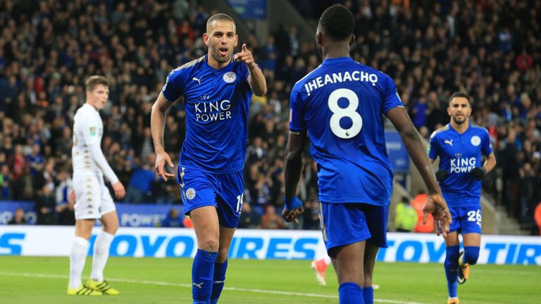 Leicester City's Algerian striker Islam Slimani (2nd L) celebrates with Leicester City's Nigerian striker Kelechi Iheanacho after scoring their second goal
