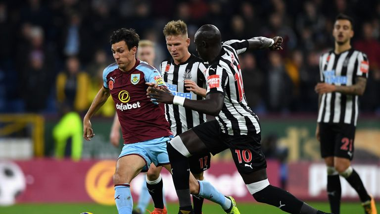 Jack Cork of Burnley is chased down by Mohamed Diame
