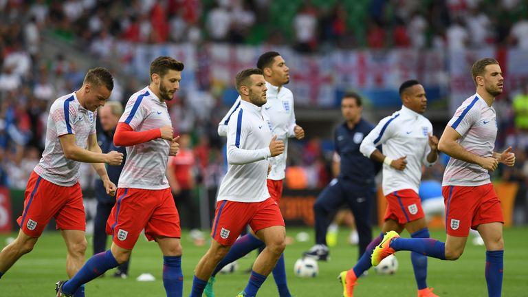 (L to R) England's forward Jamie Vardy, England's midfielder Adam Lallana, England's midfielder Jack Wilshere, England's defender Chris Smalling, England's