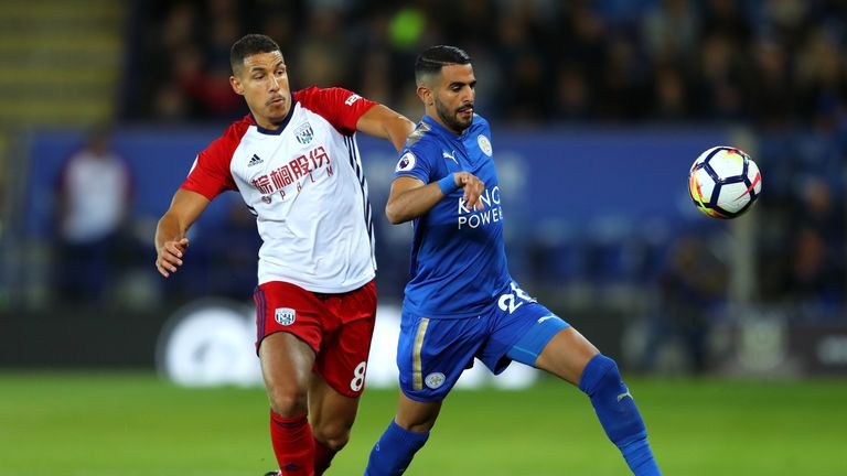 Riyad Mahrez of Leicester City and Jake Livermore of West Bromwich Albion during the Premier League match