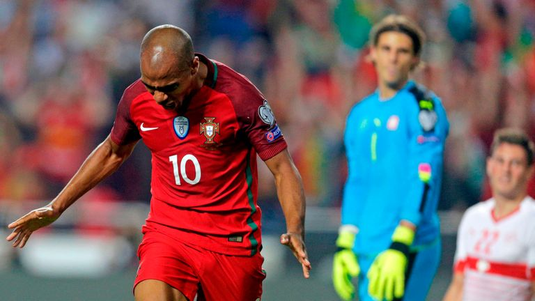 Portugal's Joao Mario celebrates following Swiss defender Johan Djourou's own goal