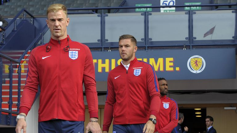 England's goalkeeper Joe Hart (L) and England's goalkeeper Jack Butland walk out to experience the stadium during a squad walkaround session at Hampden Par
