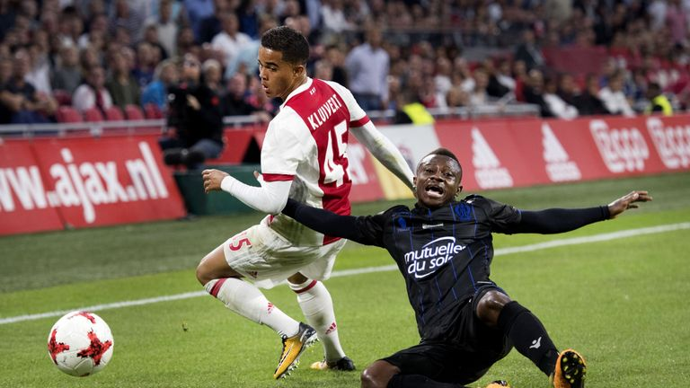Ajax's forward Justin Kluivert (L) fights for the ball with OGC Nice's midfielder Jean Seri during the Champions League second leg football match between O
