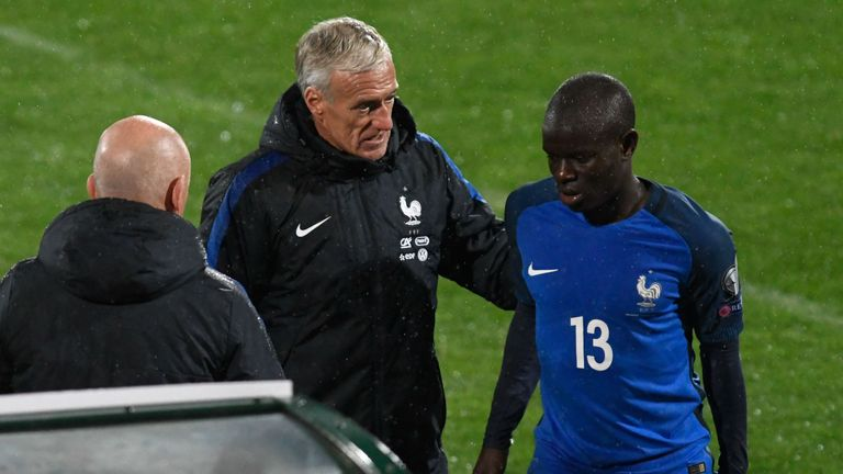 N'golo Kante is comforted by France's coach Didier Deschamps