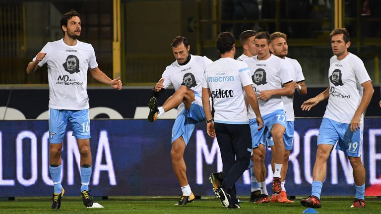 Lazio's players showing image of holocaust victim Anne Frank, warm up prior the Italian Serie A football match v Bologna