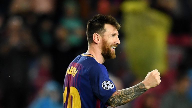 Lionel Messi celebrates scoring his 100th European goal in the 3-1 win over Olympiakos