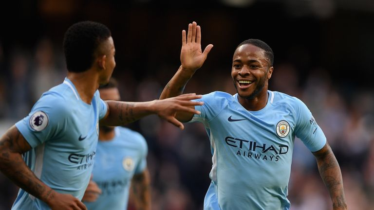 Raheem Sterling of Manchester City celebrates scoring his side's second goal against Stoke with Gabriel Jesus