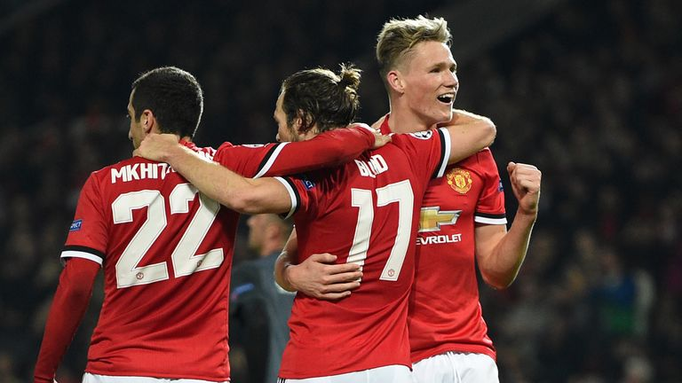 Manchester United players celebrate their second goal against Benfica
