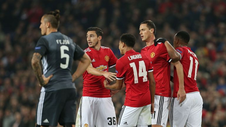 Manchester United players celebrate after taking the lead against Benfica