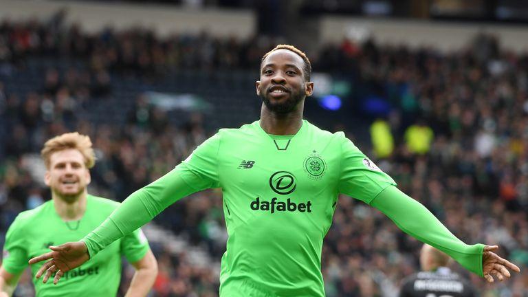 Moussa Dembele celebrates making it 3-1 at Hampden Park