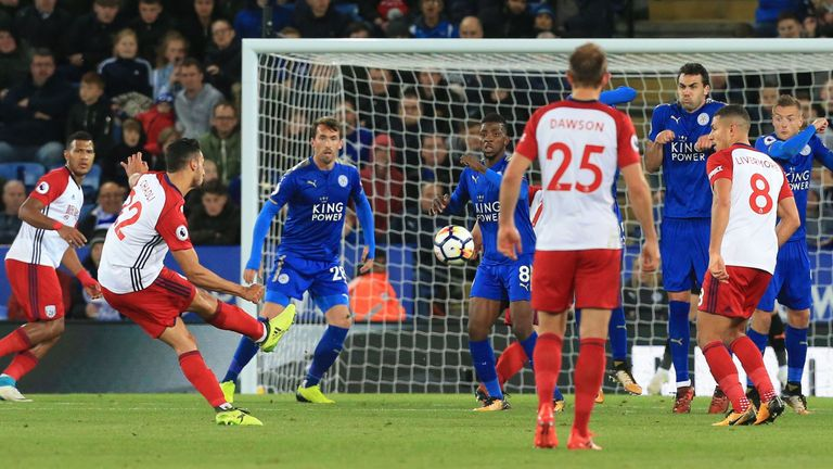 West Bromwich Albion's Belgian midfielder Nacer Chadli (2L) scores his team's first goal during the English Premier League football match between Leicester
