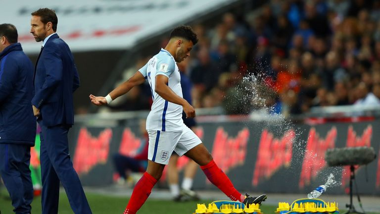LONDON, ENGLAND - OCTOBER 05:  Alex Oxlade-Chamberlain of England reacts by kicking a bottle as he is substituted during the FIFA 2018 World Cup  Group F Q