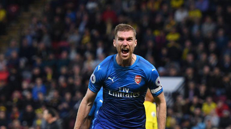 Per Mertesacker celebrates after putting Arsenal 1-0 up against Watford