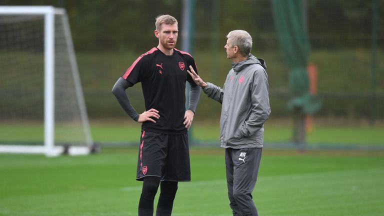 Per Mertesacker and Arsene Wenger at Arsenal training