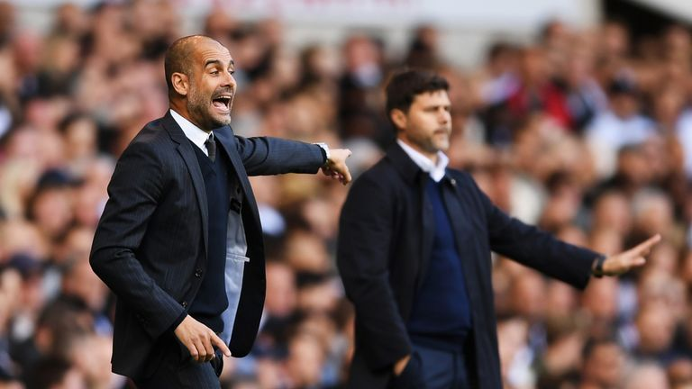 LONDON, ENGLAND - OCTOBER 02:  Josep Guardiola, Manager of Manchester City reacts next to Mauricio Pochettino, manager of Tottenham Hotspur during the Prem