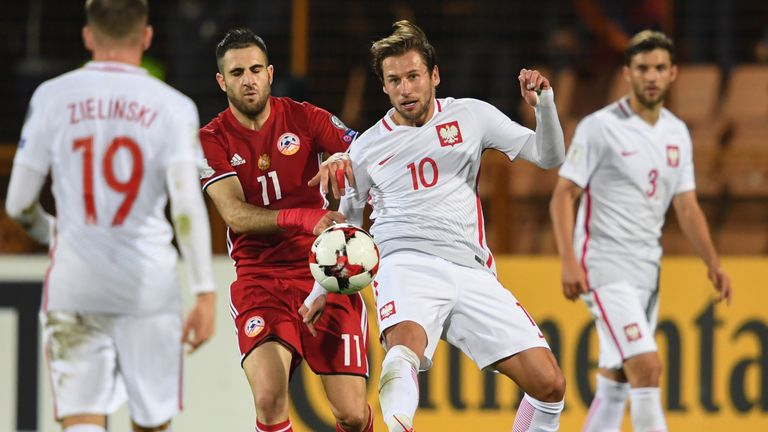 Grzegorz Krychowiak (R) tussles for possession