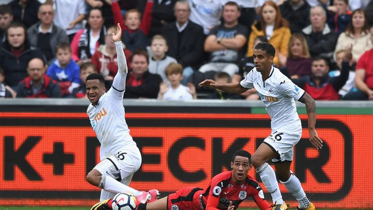 SWANSEA, WALES - OCTOBER 14:  Tom Ince of Huddersfield Town reacts to being fouled in the box during the Premier League match between Swansea City and Hudd