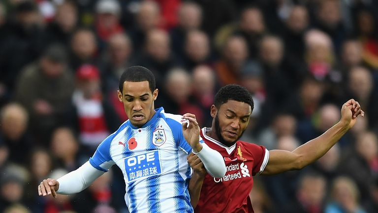 Tom Ince and Joe Gomez battle for possession during the Premier League match at Anfield