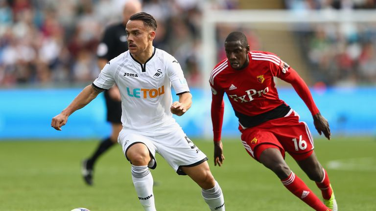 SWANSEA, WALES - SEPTEMBER 23:  Roque Mesa of Swansea City is tracked by Abdoulaye Doucoure of Watford during the Premier League match between Swansea City