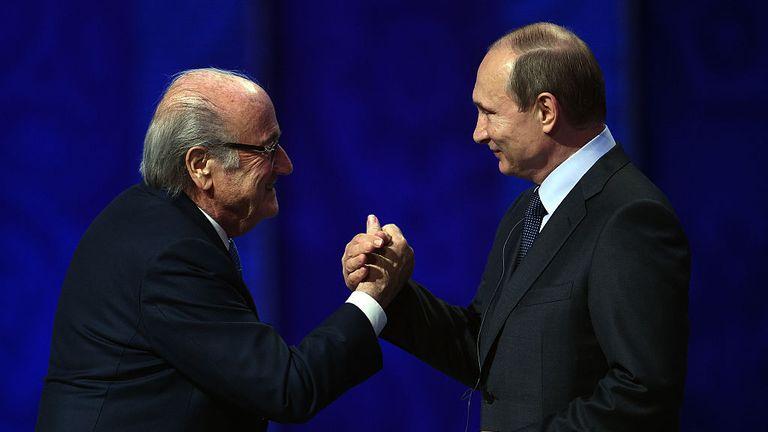 Sepp Blatter shakes hands with Vladimir Putin, President of Russia.