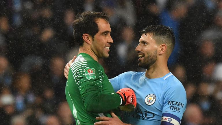 Manchester City's Argentinian striker Sergio Aguero (R) who scored the winning penalty celebrates with Manchester City's Chilean goalkeeper Claudio Bravo,
