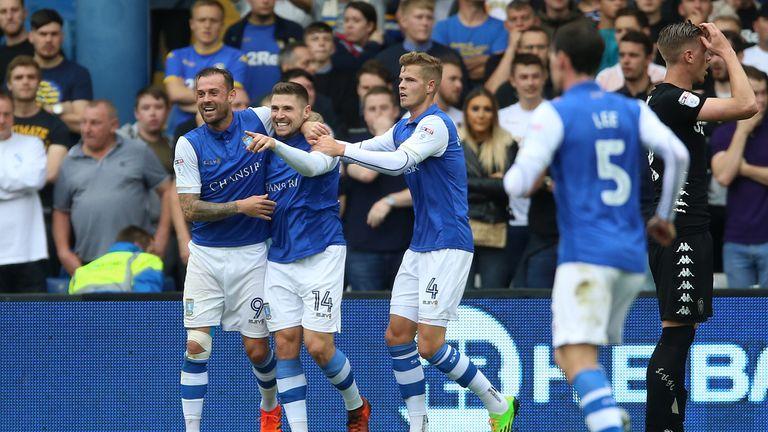 Gary Hooper (C) celebrates scoring Sheffield Wednesday's  first goal of the game against Leeds United