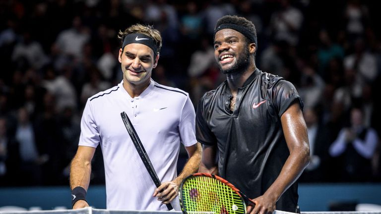 Federer (L) is congratulated on his win by Tiafoe
