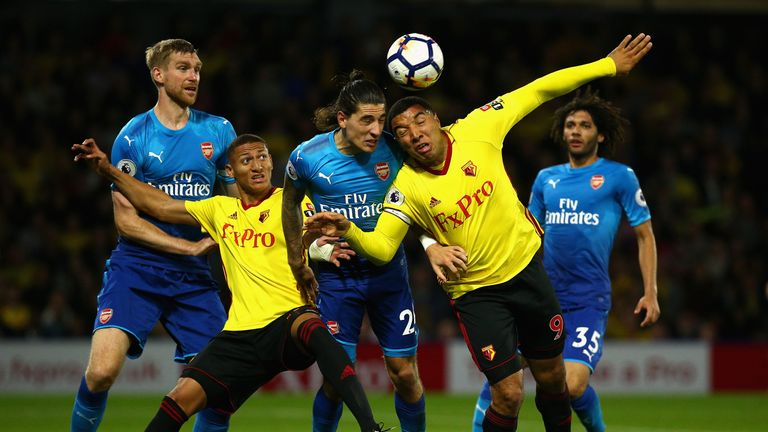 Deeney (R) battles against Arsenal defender Hector Bellerin for the ball