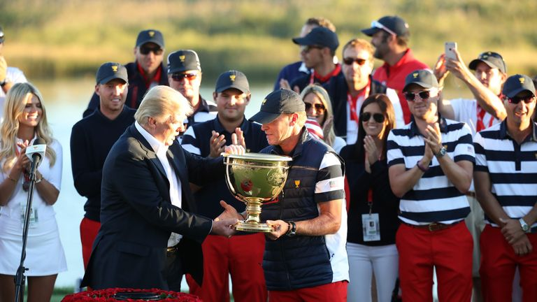 US President Donald Trump presented captain Steve Stricker  with the Presidents Cup trophy
