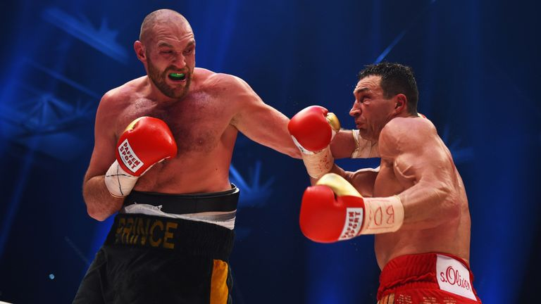 Tyson Fury in action with Wladimir Klitschko during the IBF IBO WBA WBO Heavyweight World Championship contest.