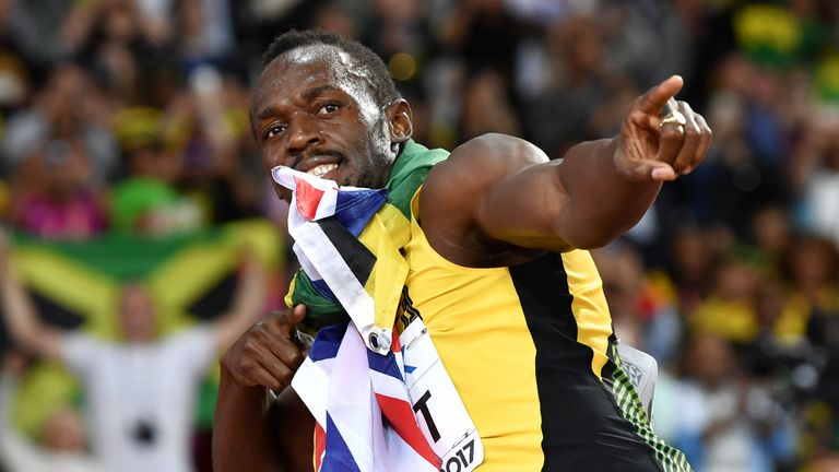 TOPSHOT - Jamaica's Usain Bolt poses after taking third in the final of the men's 100m athletics event at the 2017 IAAF World Championships at the London S