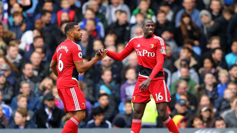 LONDON, ENGLAND - OCTOBER 21:  Abdoulaye Doucoure of Watford celebrates with Adrian Mariappa of Watford after scoring his side's first goal