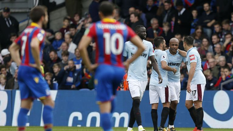 Andre Ayew celebrates with team-mates after doubling West ham's lead