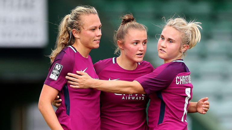 Manchester City's Geogria Stanway (centre) celebrates scoring her sides fourth goal with Claire Emslie and Isobel Christiansen during the FA Women's Super