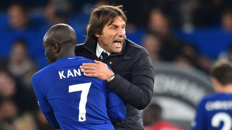 Chelsea's Italian head coach Antonio Conte celebrates on the pitch with Chelsea's French midfielder N'Golo Kante (L) after the win over Manchester United
