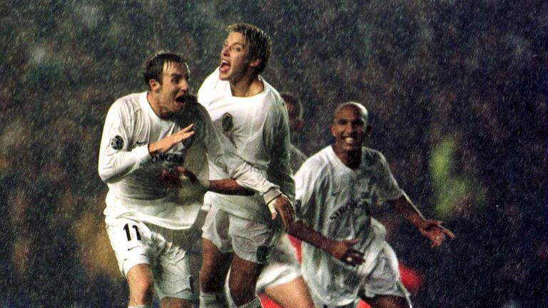 Lee Bowyer (left) celebrates after his shot is fumbled in by Dida to give Leeds victory over AC Milan