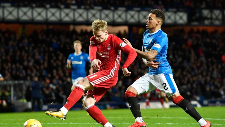 Gary Mackay-Steven (left) felt he should have had a penalty from this clash with Tavernier but nothing was given