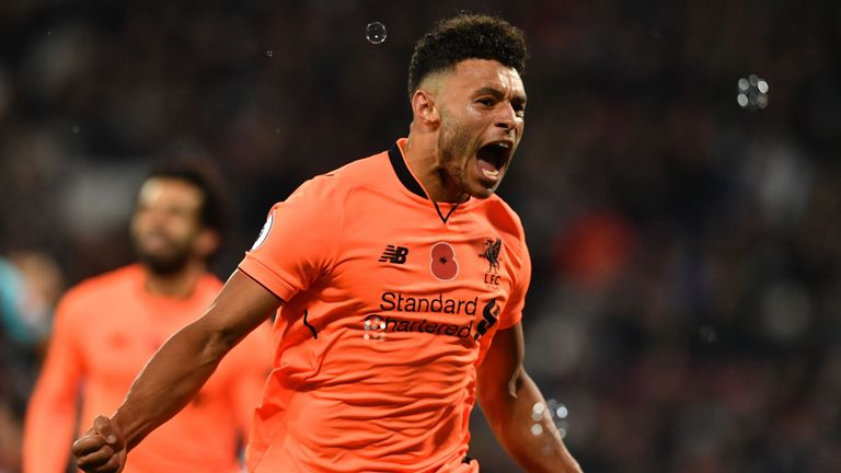 Alex Oxlade-Chamberlain celebrates after scoring Liverpool's third