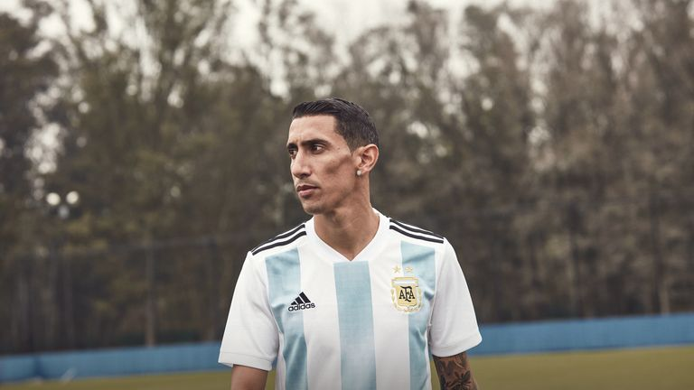 9bc1e05bf Angel Di Maria wears Argentina s World Cup home shirt