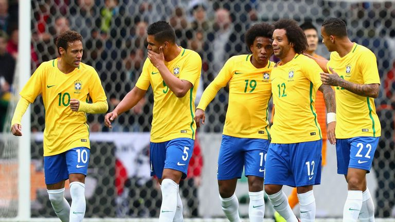 Marcelo of Brazil celebrates with team mates after scoring his sides second goal during the international friendly match betw