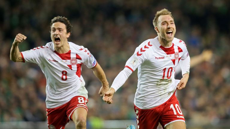 Denmark's midfielder Christian Eriksen celebrates with Denmark's midfielder Thomas Delaney (L) after scoring a goal during the FIFA World Cup 2018 qualifyi
