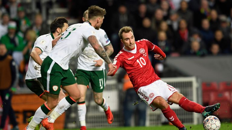 Christian Eriksen (R) of Denmark vies for the ball against Jeff Hendrick and James McClean of Ireland during the play-off FIFA World Cup 2018 qualification