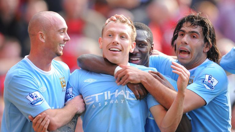 Manchester City's Welsh forward Craig Bellamy (2L) celebrates with team mates after scoring the third goal during the English Premier League football match